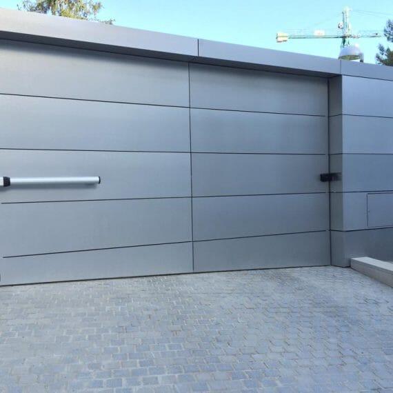 Reparación Puertas de Garaje y Mantenimiento - puertas-garaje-batientes-conmpas-570x570.jpg
