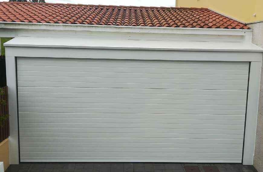Instalación Puertas Automáticas - Puertas de Garaje - puertas-garaje-seccionales-conmpas-870x570.jpg